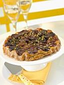 Quetsch plum and pistachio tatin tart