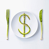 $, written with green asparagus on a plate