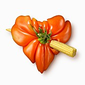 Cupid's heart made out of tomato and mini corn on the cob