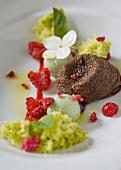 Chocolate fondant, pistachio sorbet and granita, raspberry puree