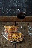 Raw ham and cheese sandwich and a glass of red wine