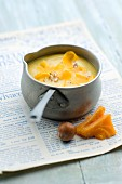 Parsnip soup with mimolette and crushed hazelnuts