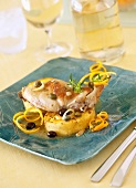 Rabbit with olives and capers, polenta with orange zests