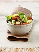 Potato,cheese,baby spinach leaf and pine nut salad with cider vinegar salad