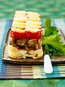 Potato, mushroom and tomato terrine