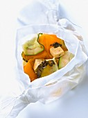 Zucchini,carrot,tofu,seaweed and soya sauce cooked in wax paper