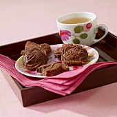 Small chocolate cakes and a cup of tea