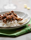 Thinly sliced caramelized turkey breasts with basmati rice