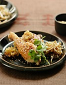 Roast chicken legs with sesame seeds