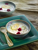 Tapioca and coconut soup with bananas and red pitahaya
