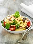 Spaghetti, octopus, corn salad and tomato salad