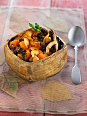 Pan-fried mushrooms, carrots and chickpeas with garlic broth