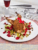 Quail coated in crushed pistachios with rose petals and green asparagus