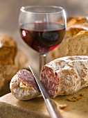 Dried sausage,bread and a glass of red wine