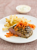 Steak with french fries and paprika sauce