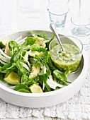 Avocado,spinach and artichoke salad with green sauce