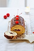 Chocolate and cherry rolled log cake