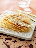 Pastilla with milk sauce and almonds