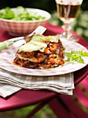 Vegetable lasagnes on a table outdoors