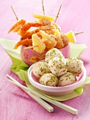 Shrimp and pineapple brochettes coated in coconut,lime-flavored rice balls