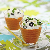 Cream of tomato soup with sliced black olives