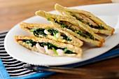 Hot shrimp-spinach sandwiches
