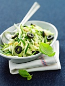 Grated zucchinis with pine nuts and olives