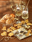 Almond-flavored choux buns, ribbon of shortbread cookies, Chocolate-orange Pannequets and Champagne with marshmallows and chocolate