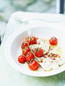 Piece of cod with Virgin sauce and grilled bunch of tomatoes