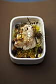 Thick piece of cod with herbs and lemon