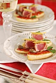 Tuna Crostinis with capers and cilantro