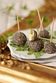 Foie gras balls coated with poppyseeds