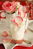 White chocolate and wild strawberry cappuccino with rose petals
