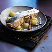 Thick piece of salmon with grapes