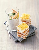 Tzatziki with shrimps, salmon and turmeric mini club sandwiches