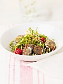 Salt cod fish balls with poppyseeds and mixed vitamin salad