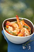 Pan-fried gambas and vegetables with sesame seeds