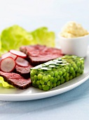 Cold roast beef with peas in aspic