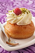 Rum Baba with raspberry and crushed pistachios