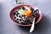 Squid ink tagliatelles with shrimp and salmon roe