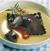 Cocoa ravioli with caramel filling, rosemary-flavored custard