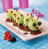 Caterpillar-shaped mint ice cream with chocolate sauce