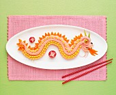 Chinese dragon made out of tarama,carrots and sweet corn