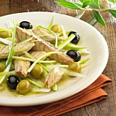 Mackerel on spring onion salad with black and green olives