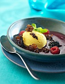 Chocolate soup with fruit and mushrooms and a scoop of ice cream