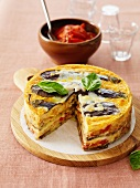 Vegetable savoury cake with tomato sauce