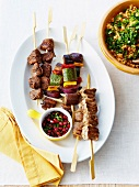 Beef and vegetable brochettes ,pomegranate sauce,bulghur with herbs