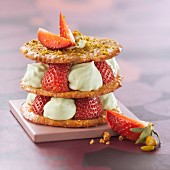 Crunchy pastry, strawberry and pistachio whipped cream dessert