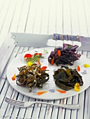 Wakame seaweed nest and sea thong nests with flower petals