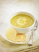Cream of zucchini and leek soup with rice vermicellis and sesame seeds